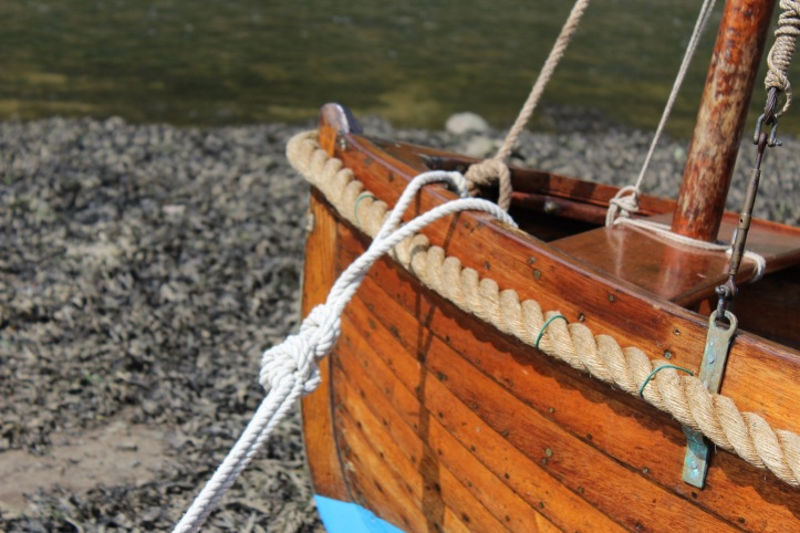 A beautiful wooden boat in the sunshine at Solva, Pembrokeshire.